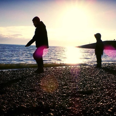 Seaside silhouette. #beach #seaside #shadows #sun #england #pebbles #sea #wintersun #sea #kids #silhouette