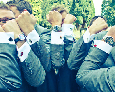 The groom and ushers are superhero fans